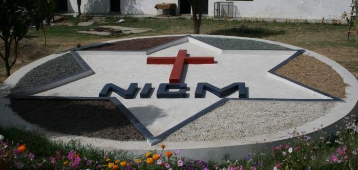 NICM Crest